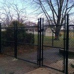 Commercial-black-vinyl-coated-chainlink-with-barbed-wire